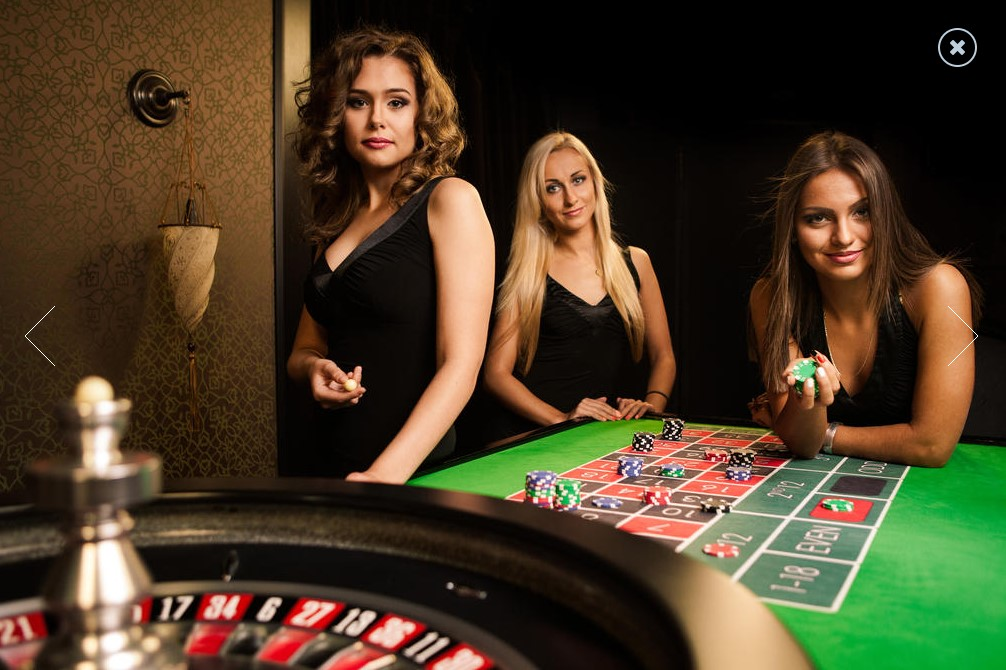 Live dealer hosts around a casino table.
